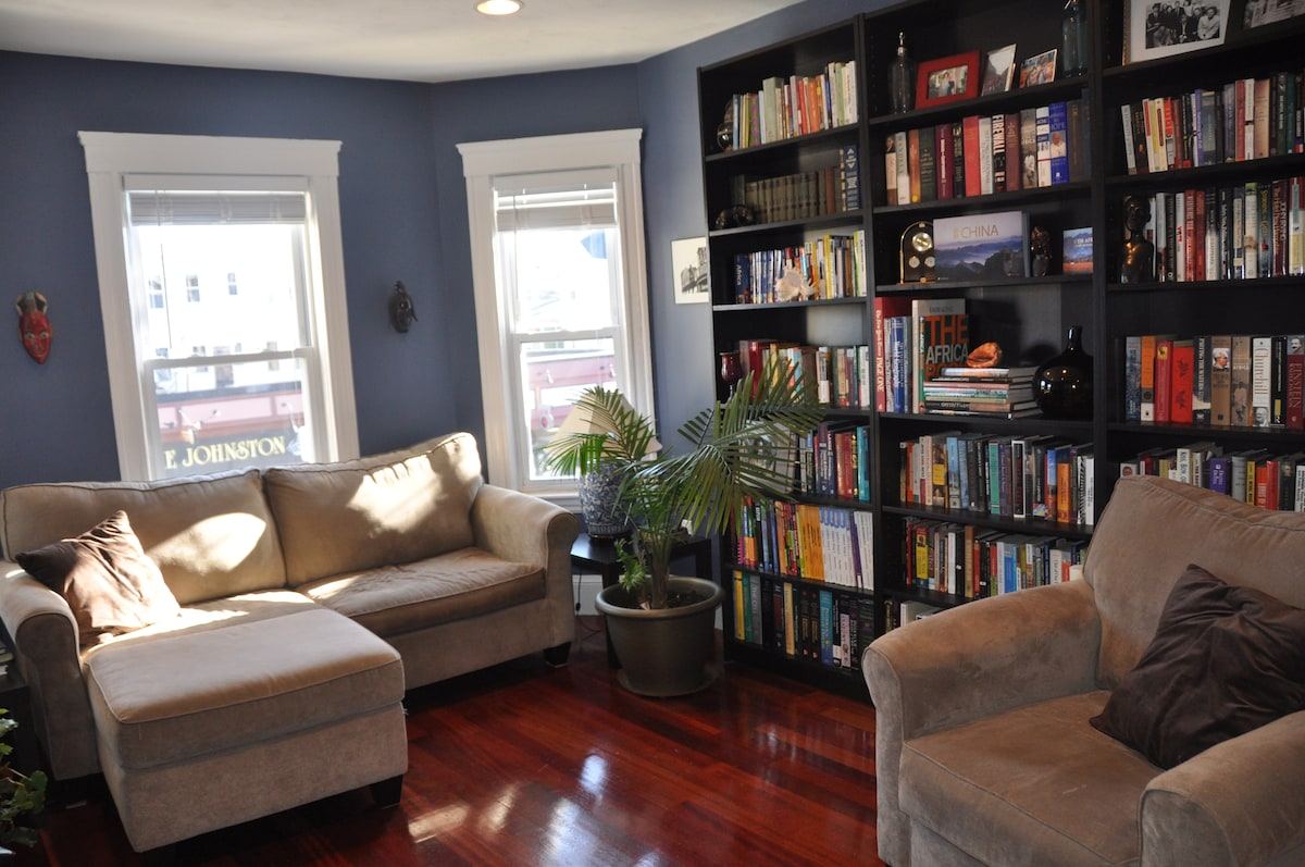 Living room with large library to peruse
