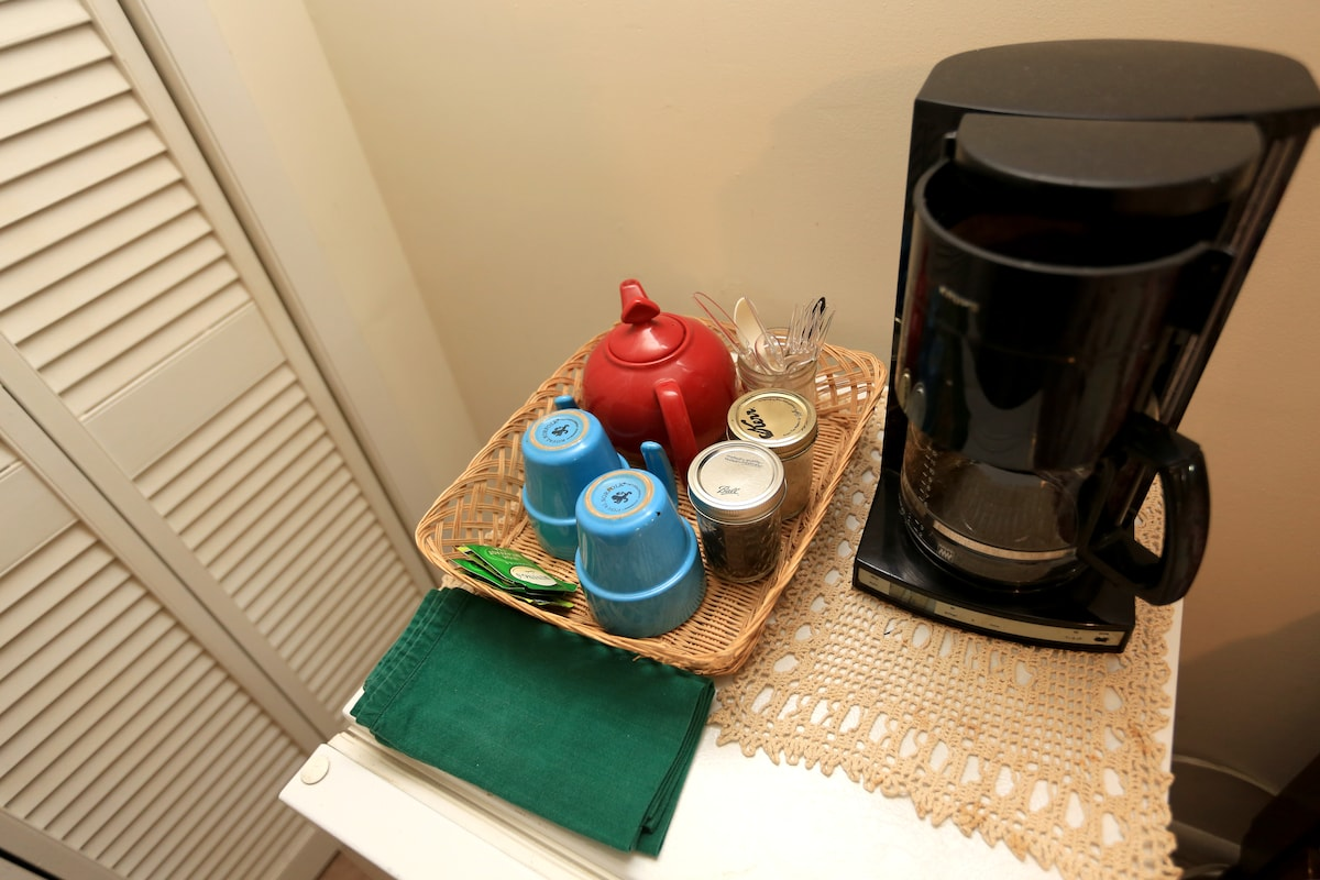 There is coffee-maker and small fridge.