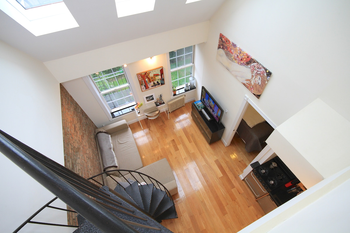 View into living room from staircase up to roof deck