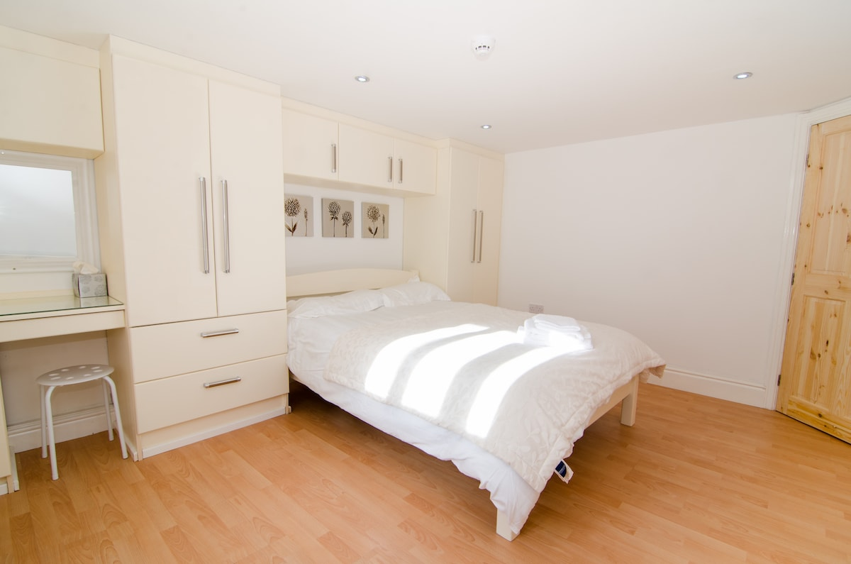 Bedroom with fitted wardrobes and dressing table