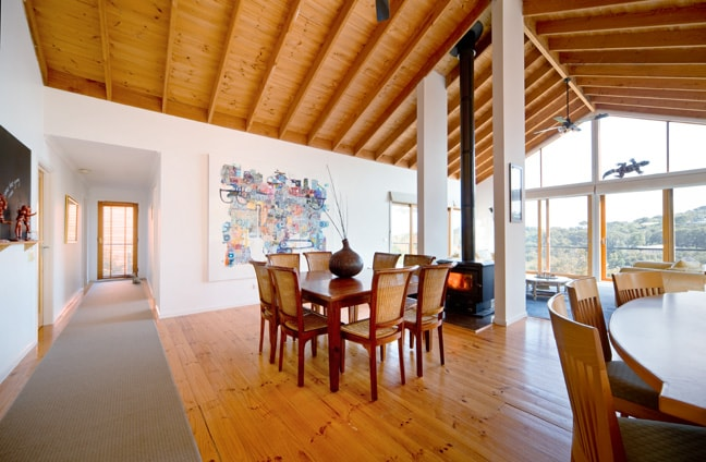 The high ceilings, with seasonal adjusted fans, double sided wood burning heat .