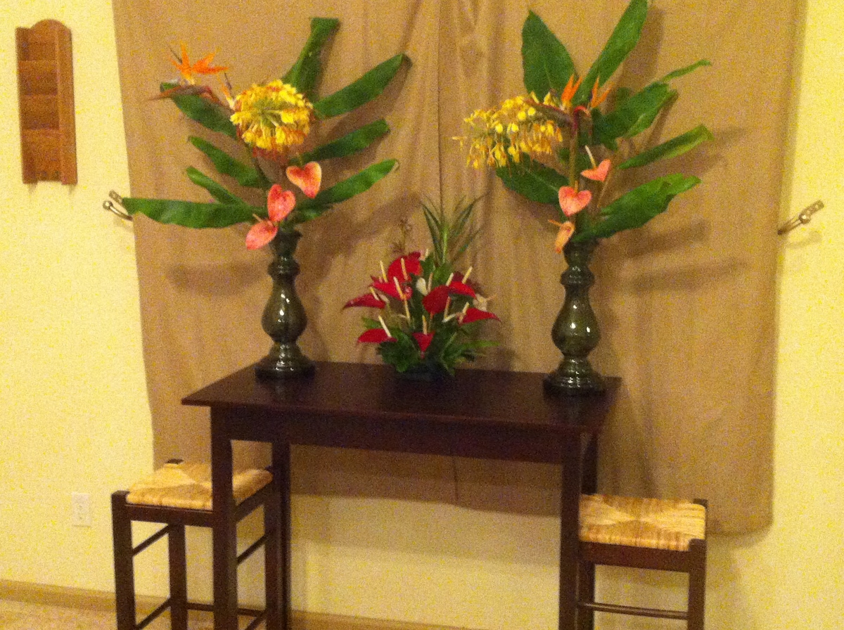 Entry table used to provide guests with business cards, brochures, guest book, and information binder.