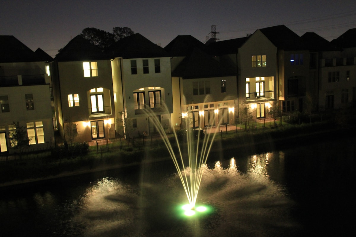 View of the fountain from the deck at night.