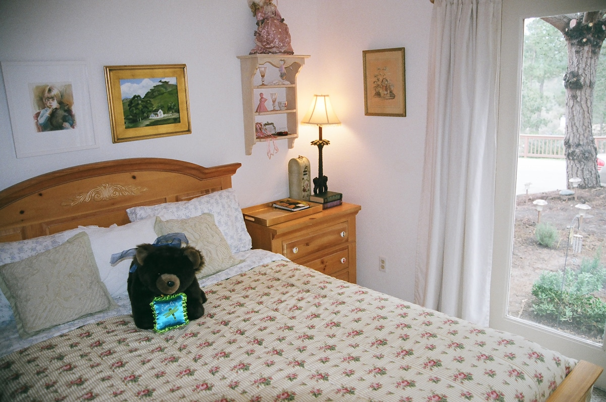 "Bedroom 1: Queen Bedroom.  Private French door entry, 32"" flat screen TV and DVD player, free Wiifi. desk and faux electric fireplace"