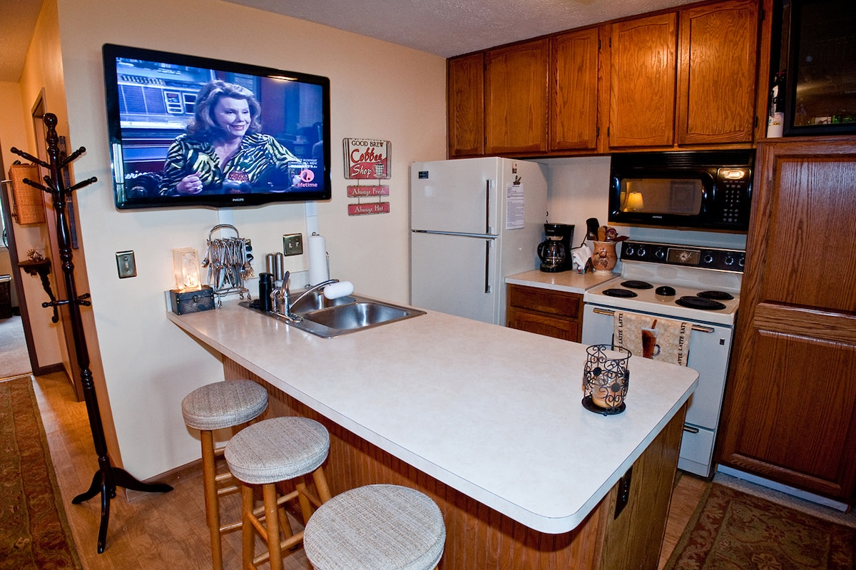 46 inche flat screen TV with cable. Kitchen has full sized fridge and dishwasher.