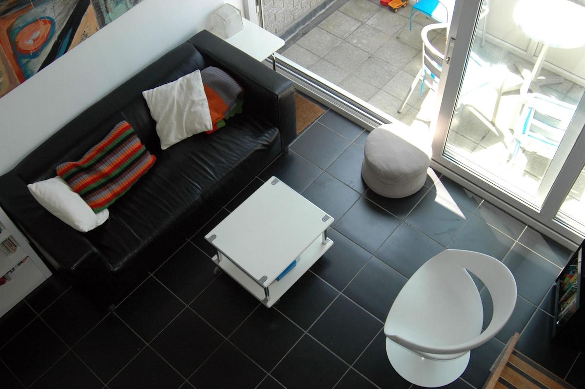 View of living area from mezzanine floor, underfloor heating throughout the flat.