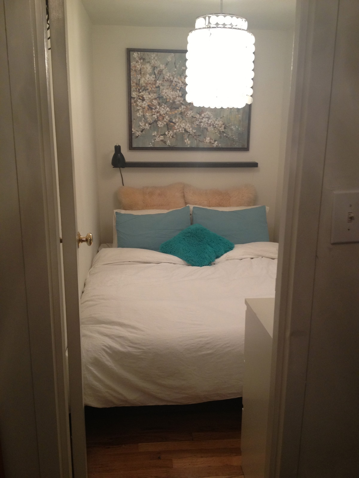 Beautiful cozy queen size comfortable bed with lots of pillows!