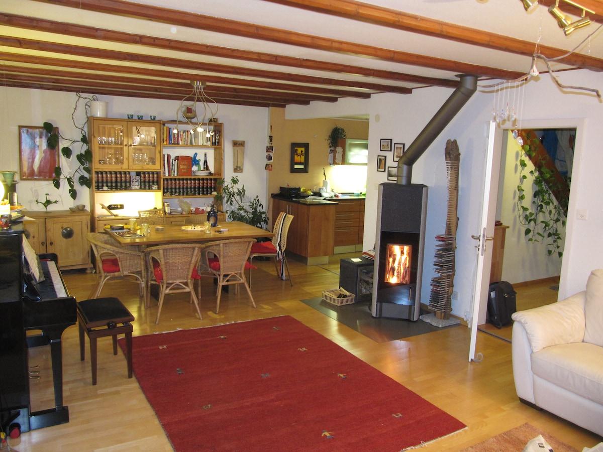living room with kitchen and door to hallway