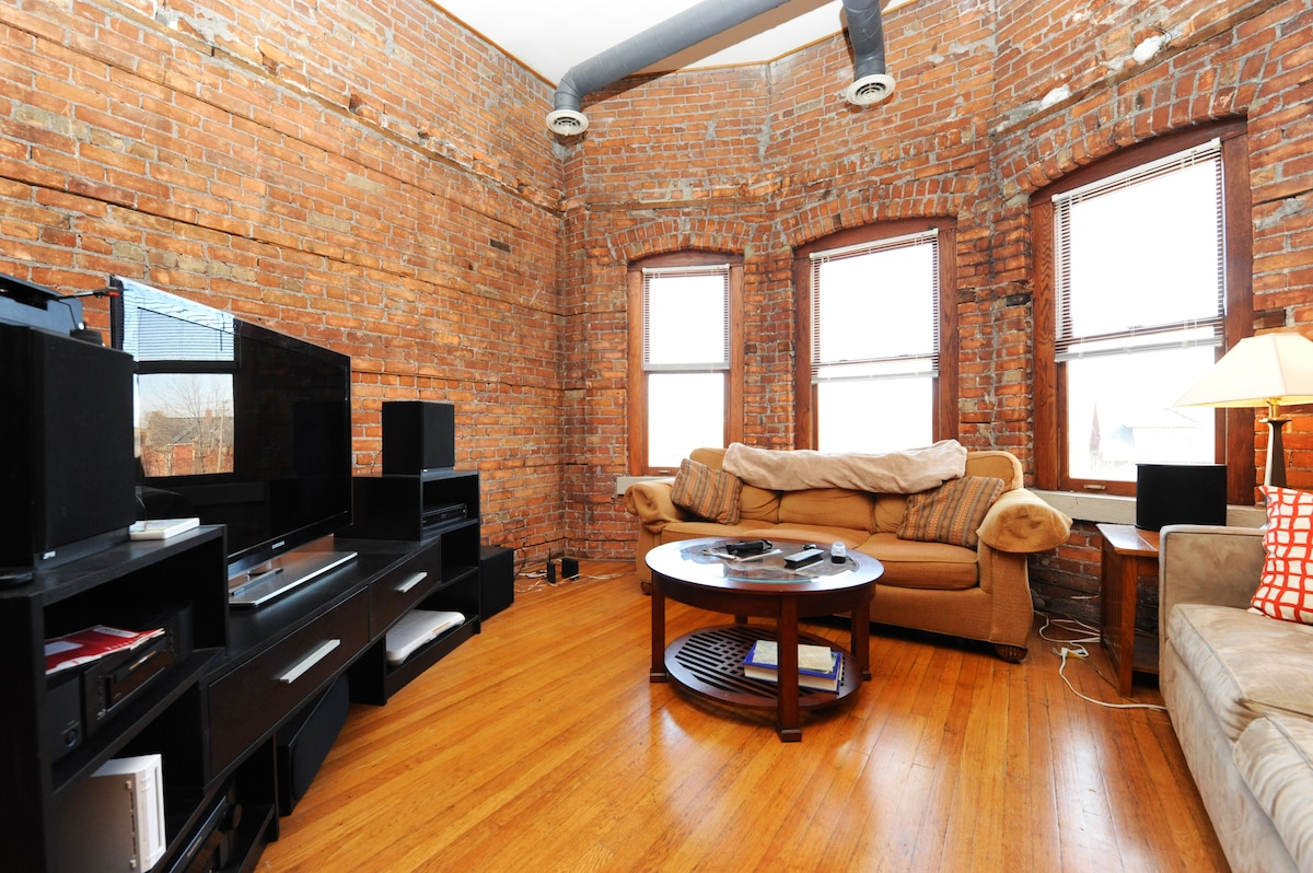 Living Room, note the exposed brick