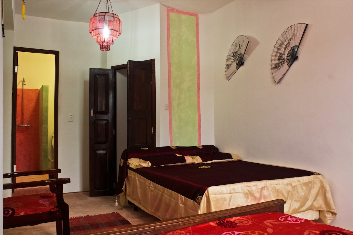 Asiatic room for three people a double bed