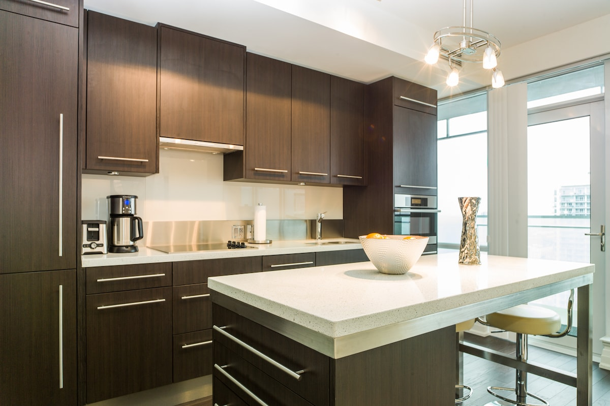 Beautiful kitchen with top of the line Miele appliances to create memorable culinary creations!