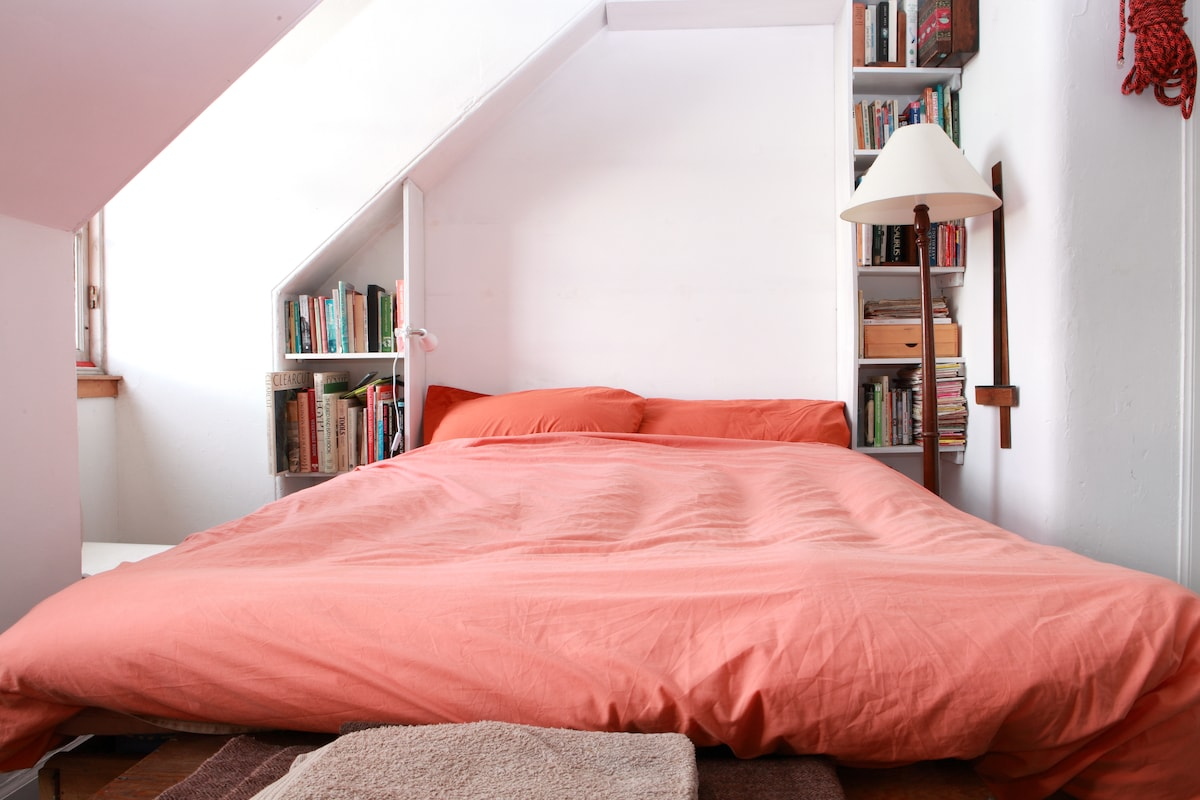 Bed withwarm feather duvet, books to read and stunning views to wake up to.