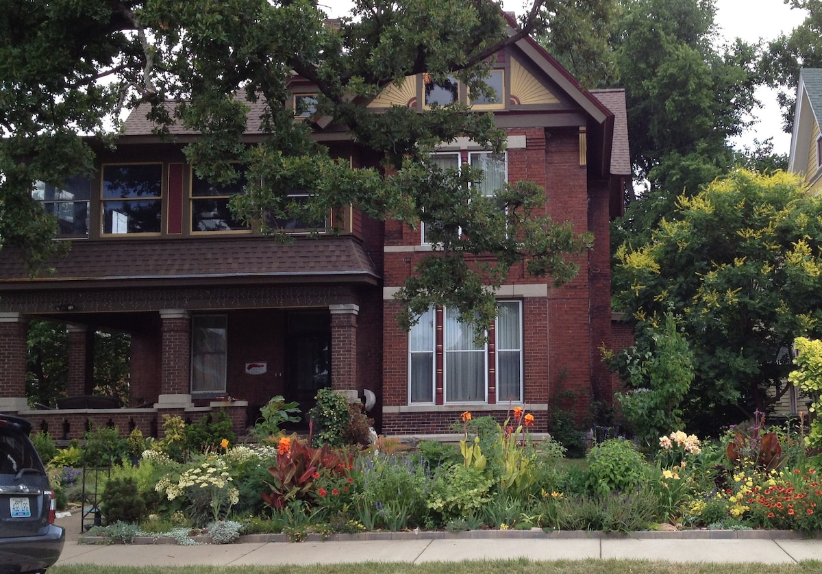 The Mavhouse, built in 1897. Shown here with the flowers of high summer in full bloom.