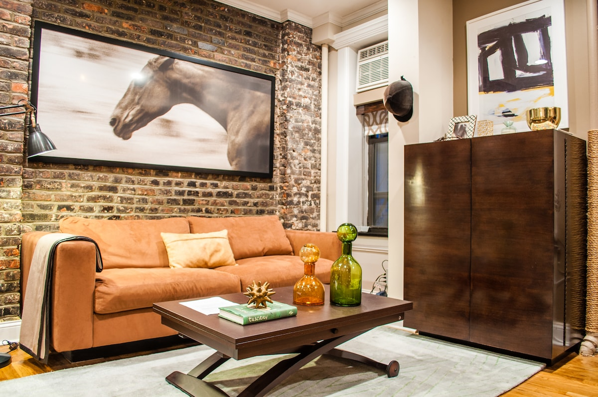 Living Room with famous massive photography art on the wall by well known artist
