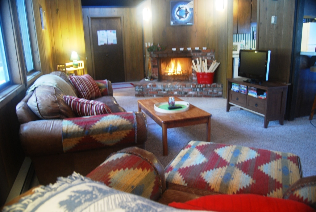 Cozy living room with wood burning fireplace (wood included). CATV/DVD with lots of movies, toys, games and books.