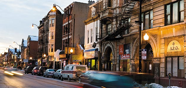 Picture of a typical pilsen street which features Czech architecture, lots of places to get international food (Chinese, Mexican, Indian, etc.), cool bars, galleries, little shops and vintage stores, and more.  This neighborhood is absolutely charming.