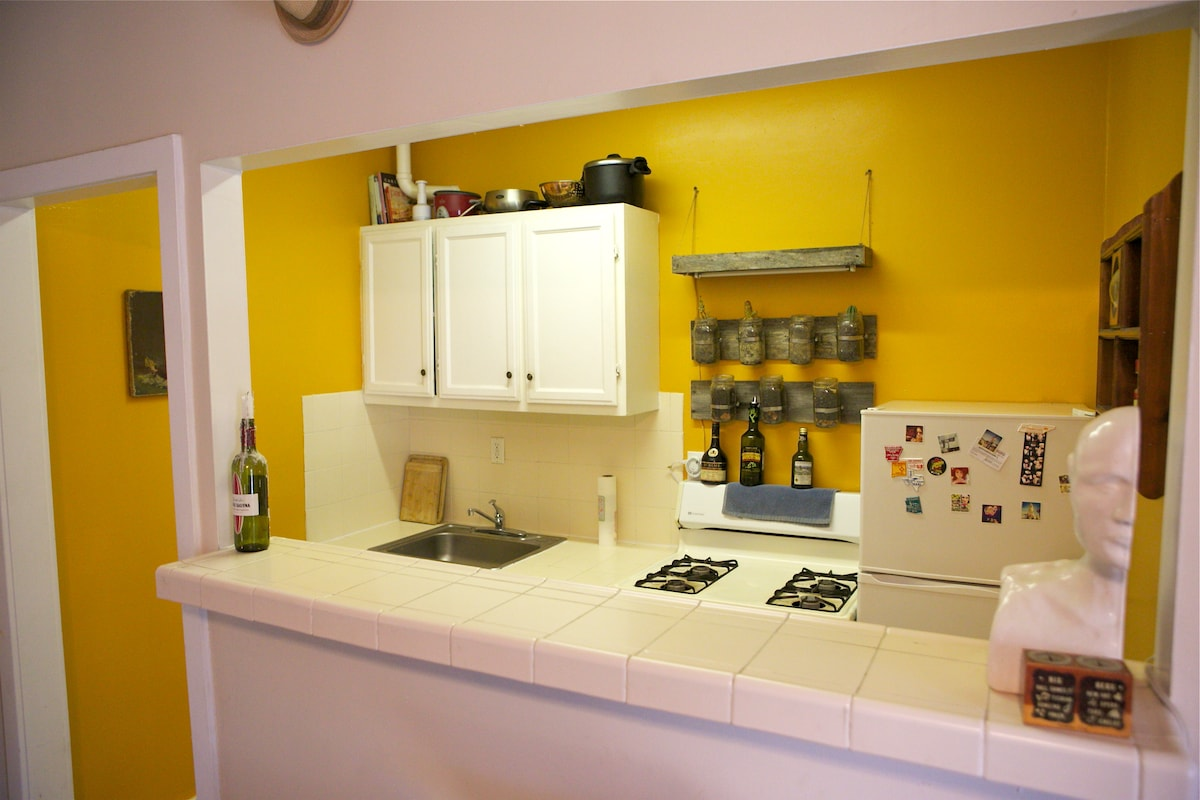 The orange kitchen, ready for you to make home cooked meals.