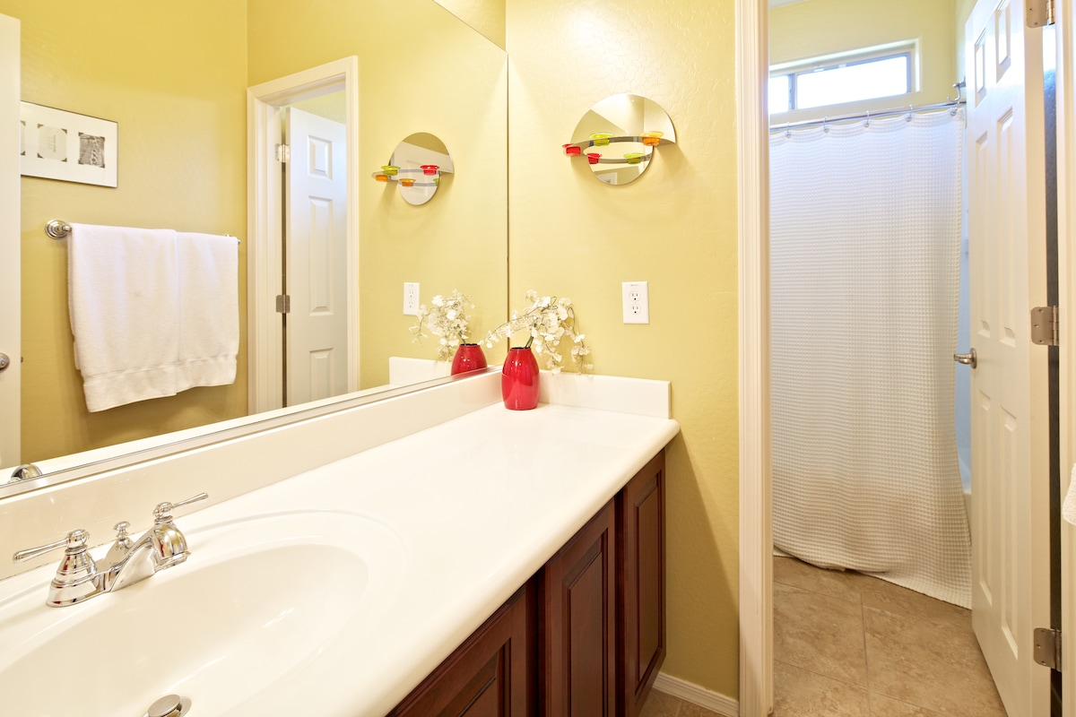 The shower and toilet have their own room, plus there is another half bath available on the 1st floor.