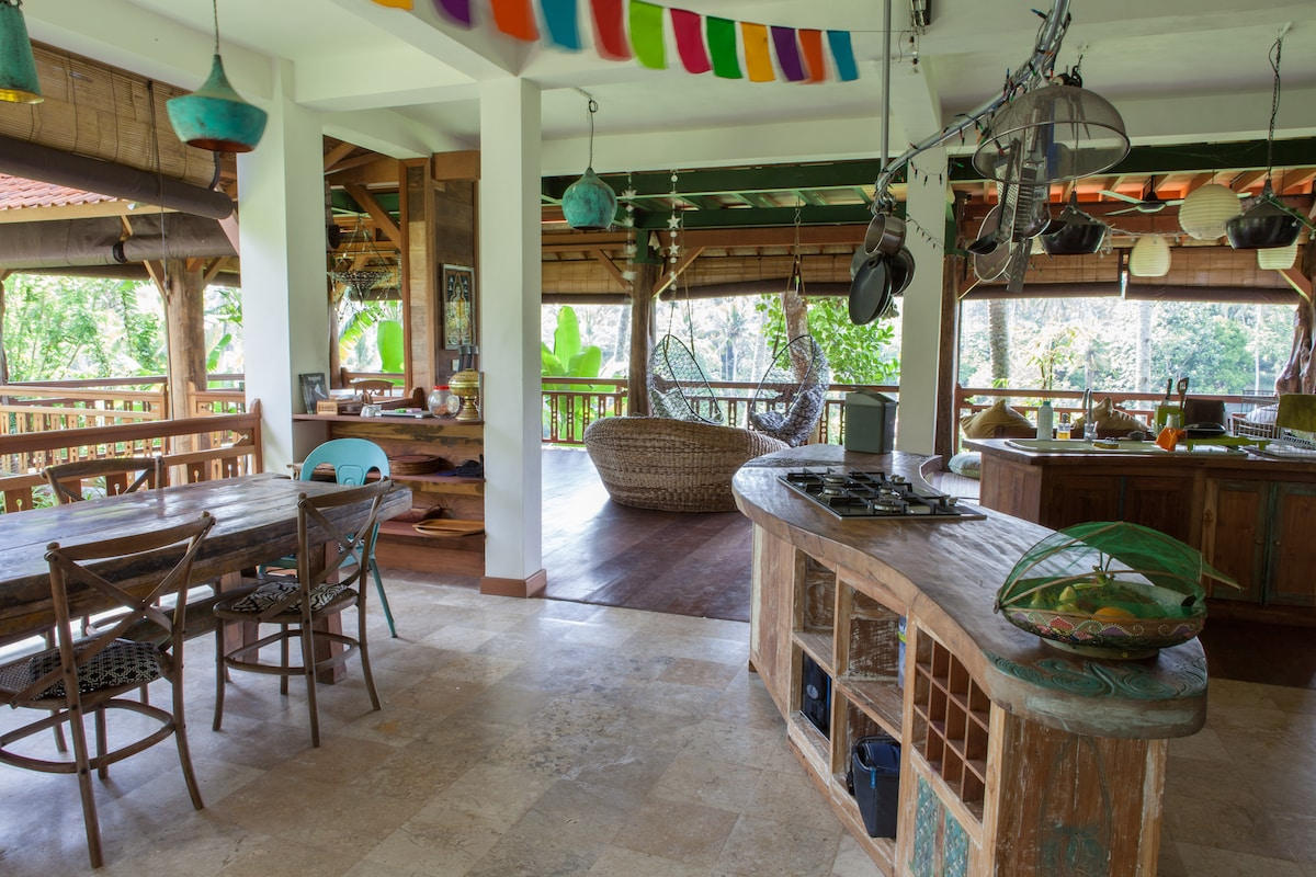 The kitchen in the main house. We've designed the entire house using many different types of reclaimed tropical hardwoods.