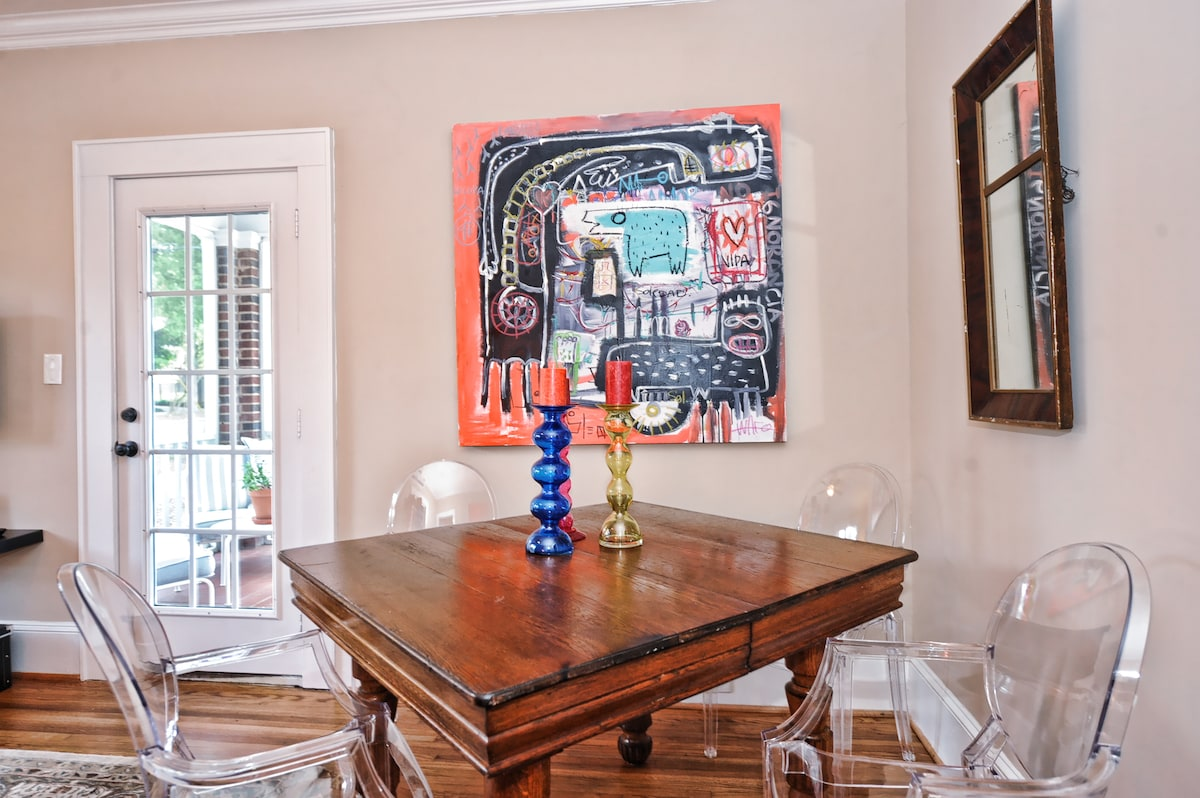 This wonderful ground floor apartment features all original artwork by local artists