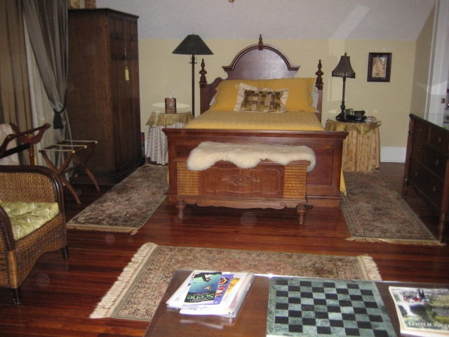Willow Branch Room.  Large comfy bedroom with sitting area, desk and private bath.