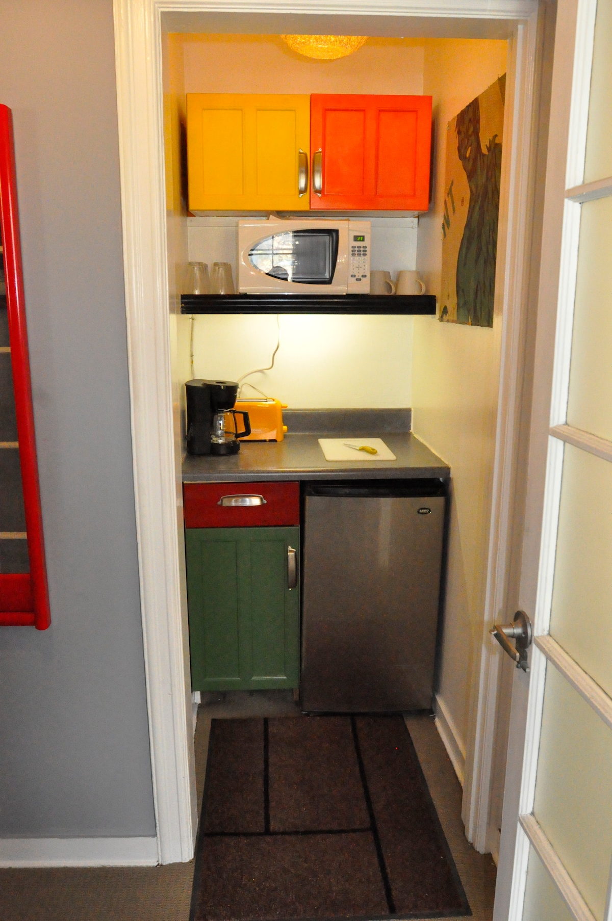 A mini-fridge, microwave, and coffee maker for your convenience.