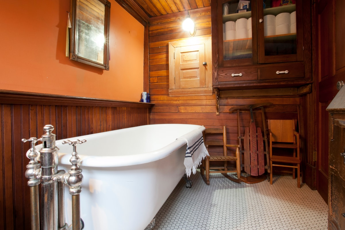 Private bath with 1905 Clawfooted Tub in balcony room