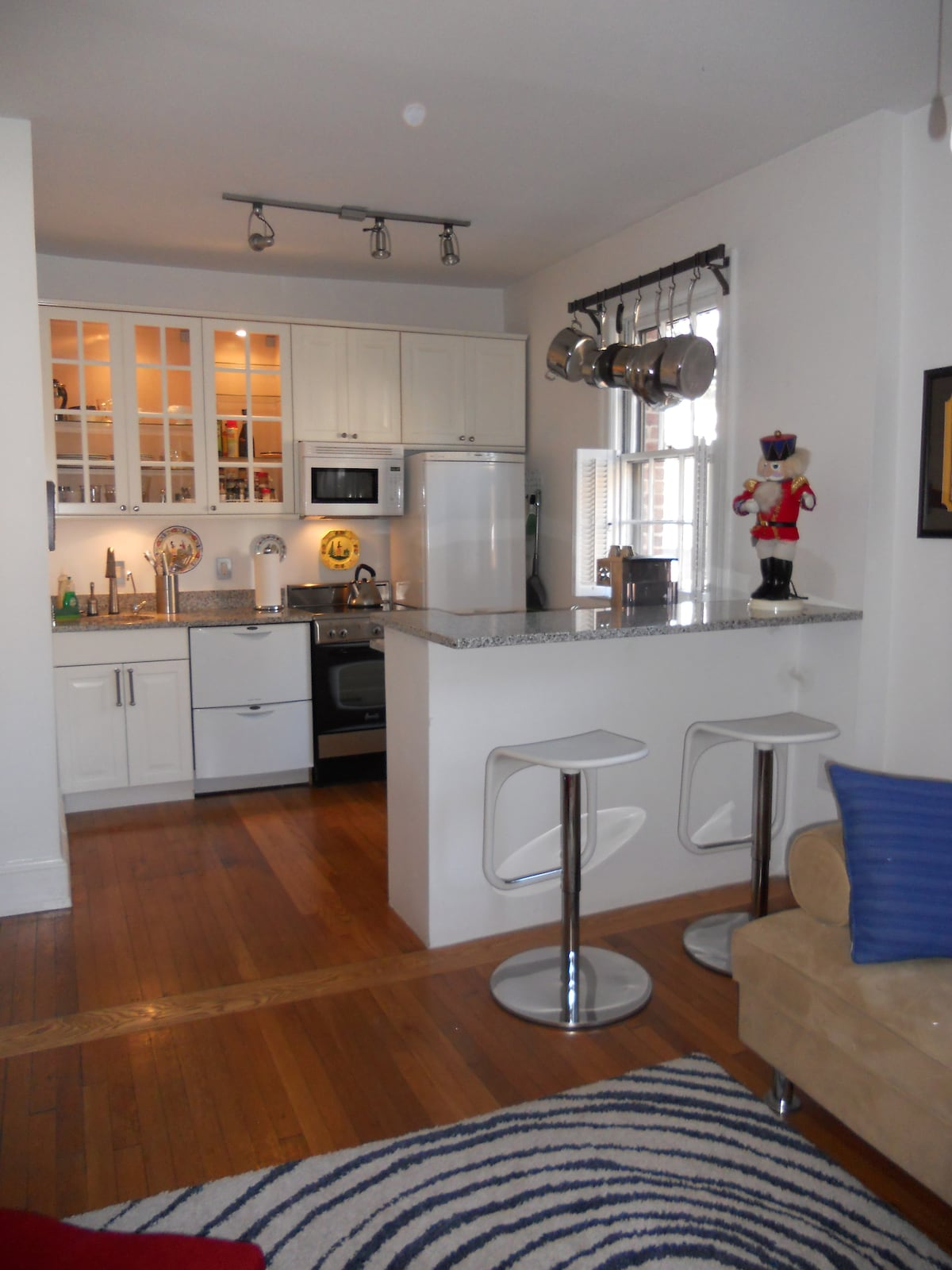 Cozy kitchen and breakfast bar, completely furnished.  Guests love to leave stuff for the next guest, wonder why?