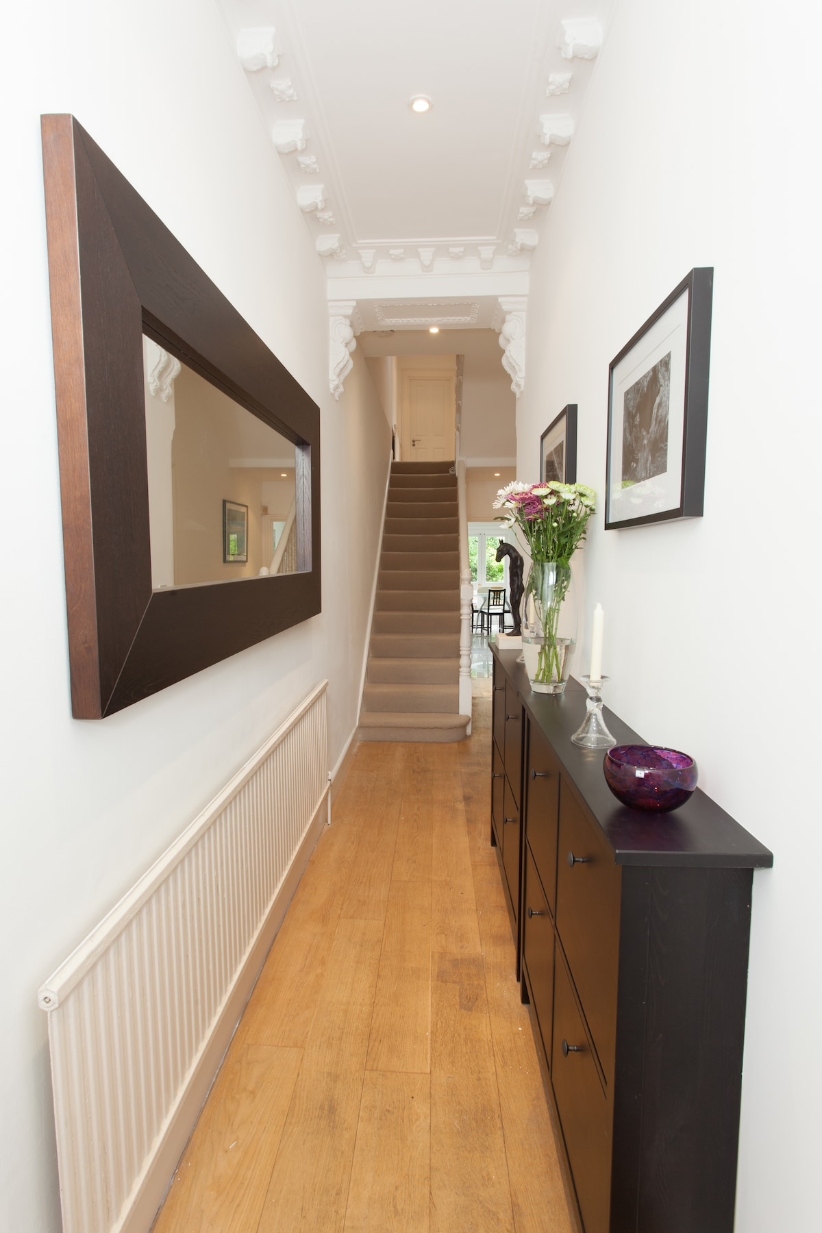 Entrance Hallway, with large mirror adds to a feeling of spaciousness.