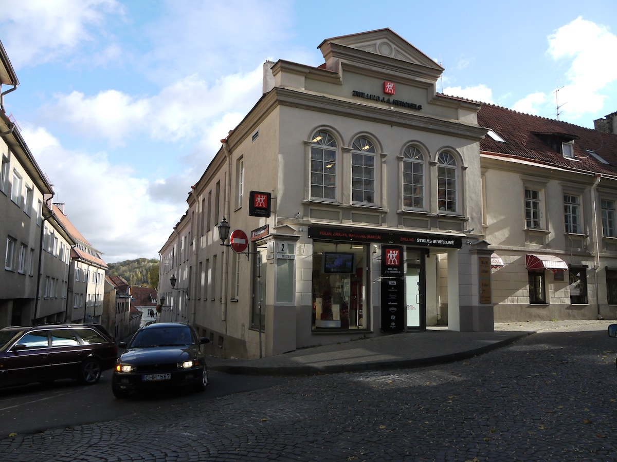 Apartment is in this historic building; entrance is to the right of the store.