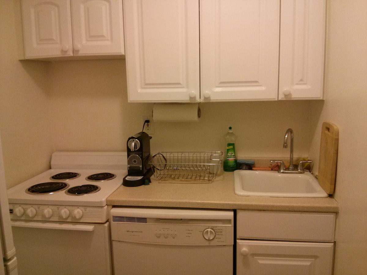 Kitchen with Nespresso machine, stove top, dish washer