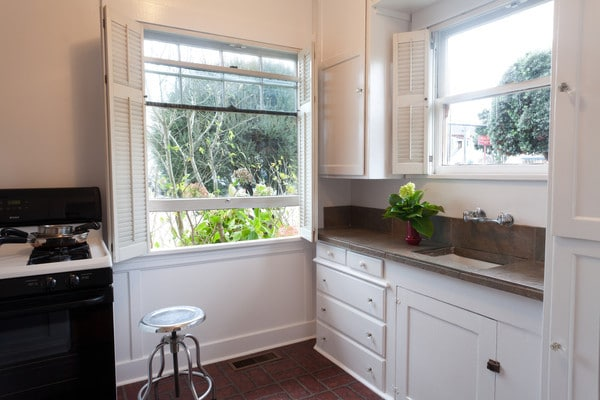Sunny kitchen, microwave and refrigerator out of view.