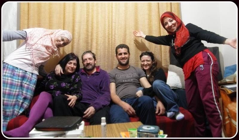 Algerian,Italian couple,and algerian American couple,laughing,eating,drinking tea and talking all together.