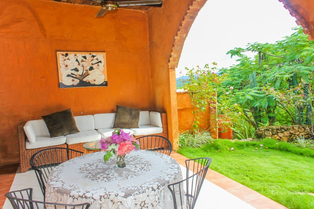 Back patio open to private fenced in garden..