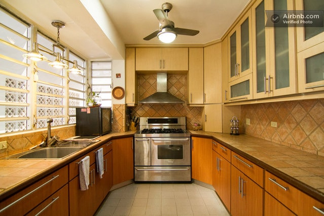 Kitchen fully equipped to be shared by guests and owner