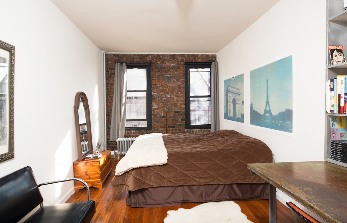 YOUR BEDROOM: Private room with exposed brick wall.