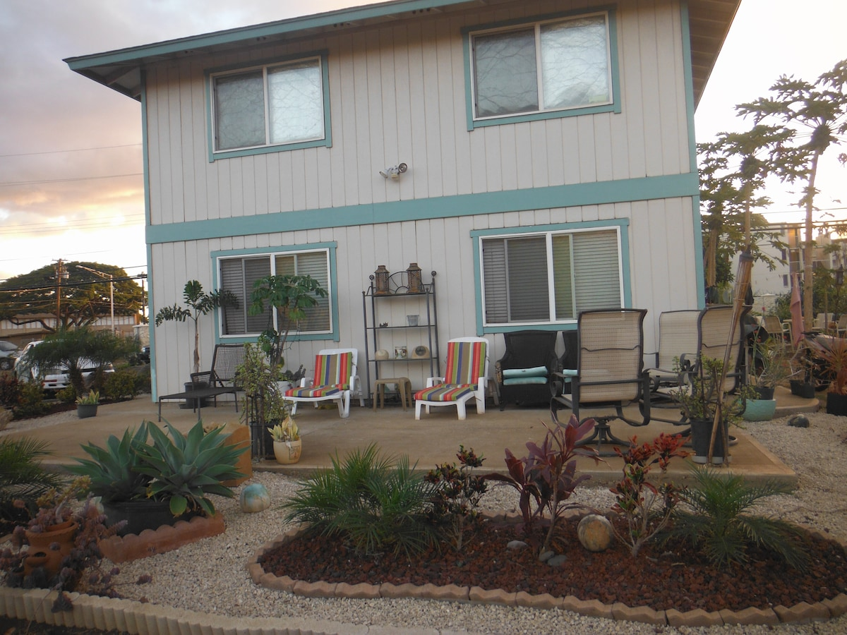 Relaxing patio and lanai in rear of house