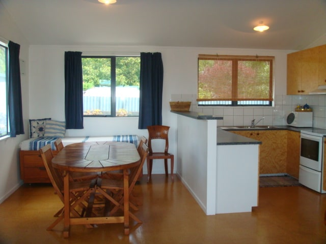 Bungalow 1, partial view of kitchen and dining area.
