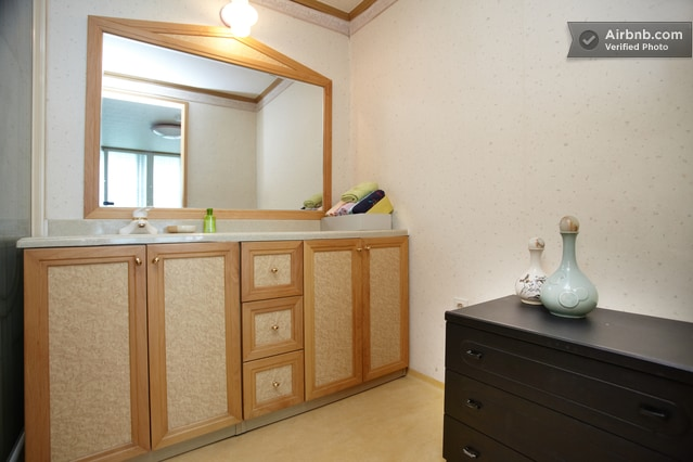 Your private washroom with a big mirror and other supplies