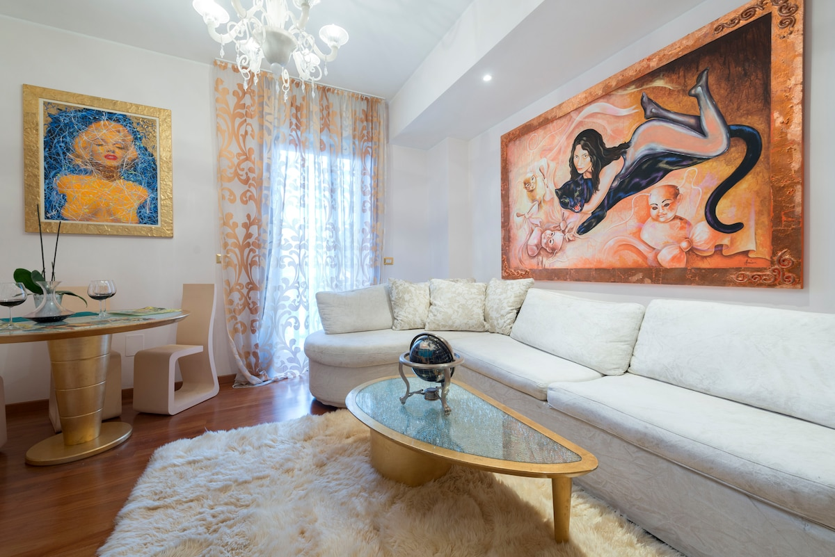 It is living room, this what you see when you enter the apartment through a small hallway. The windows are facing East.