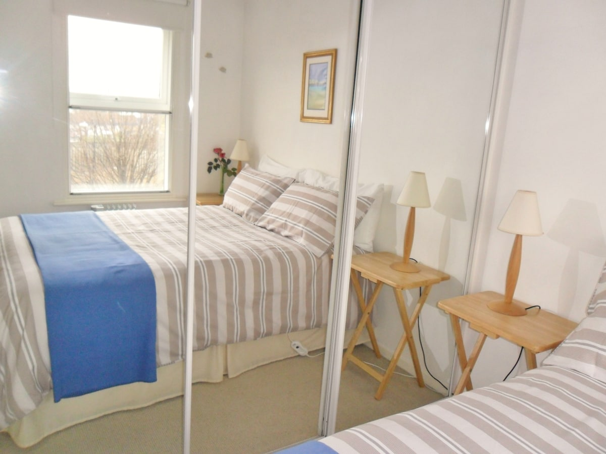 Mirrors, Wardrobe and Double Bed