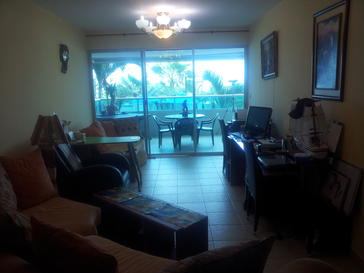 Lounge/Living Room~ TV with International Stations, DVD, Computer, WIFI (overlooking Spacious Balcony Dining Area & Pacific Ocean)