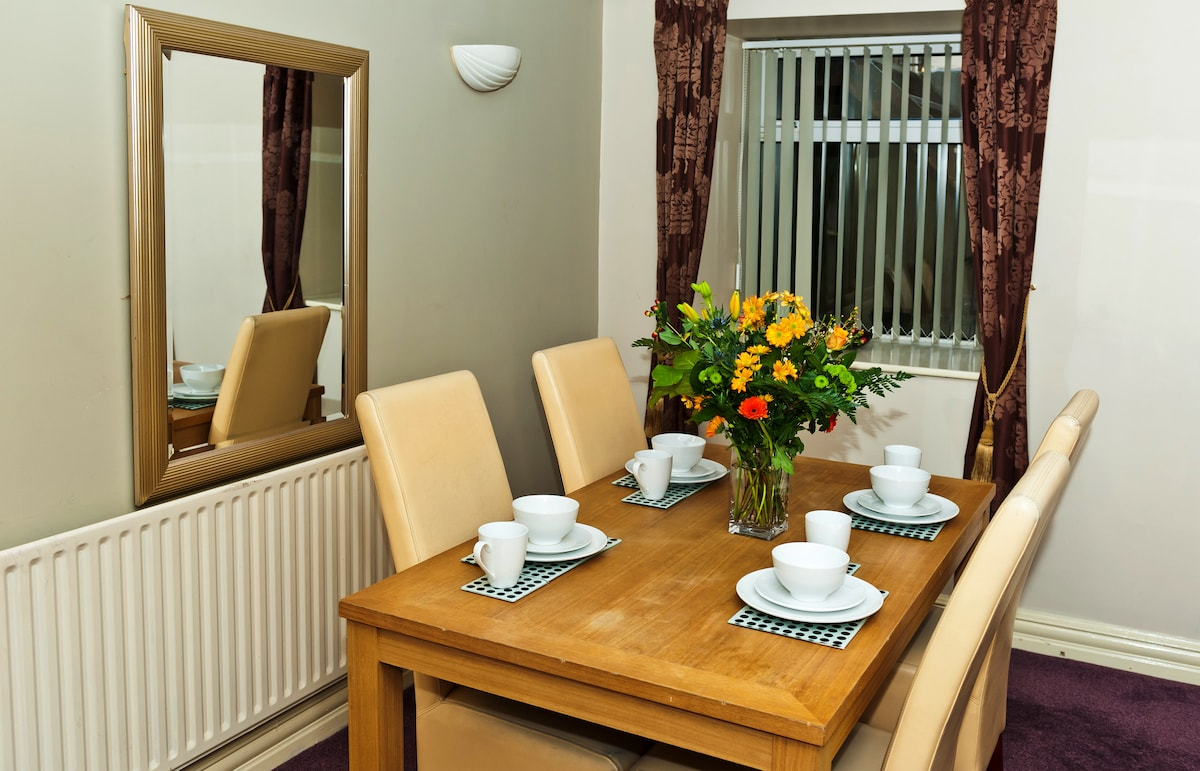 The dining table has four leather chairs to ensure one's comfort whilst eating.