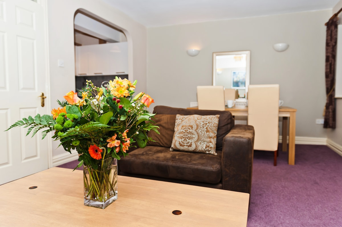 The sitting room has comfortable couches and a dining table that seats four.
