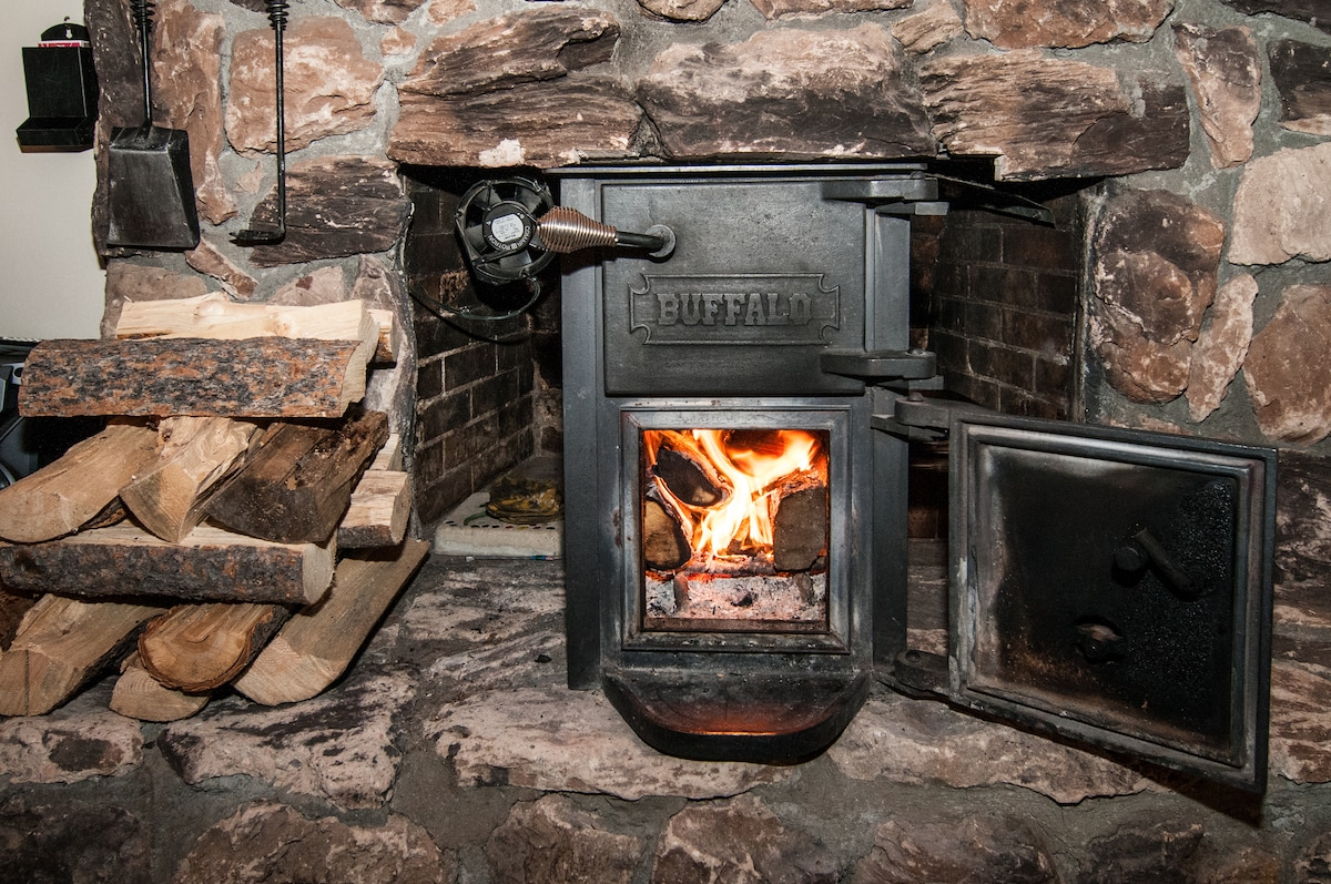 Enjoy the natural warmth of the wood-burning stove