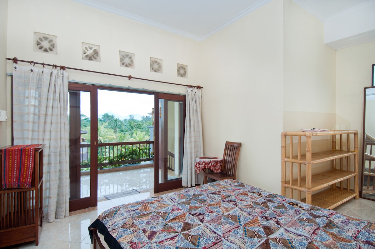 DI Atas bedroom light and airy bedroom has double bed, a stunning view from the balcony, and ample storage room.