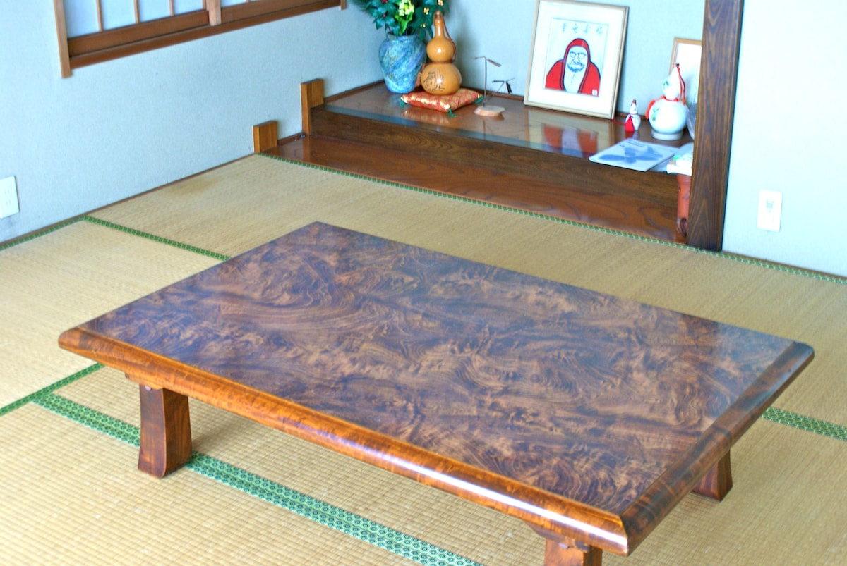 The Guesthouse main tatami room also opens to the garden.  When the wooden table is moved to accommodate a plush futon, you have a bedroom in true Japanese style.