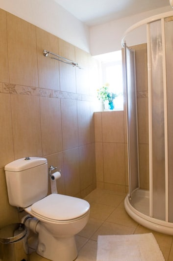 A second well decorated bathroom with shower!
