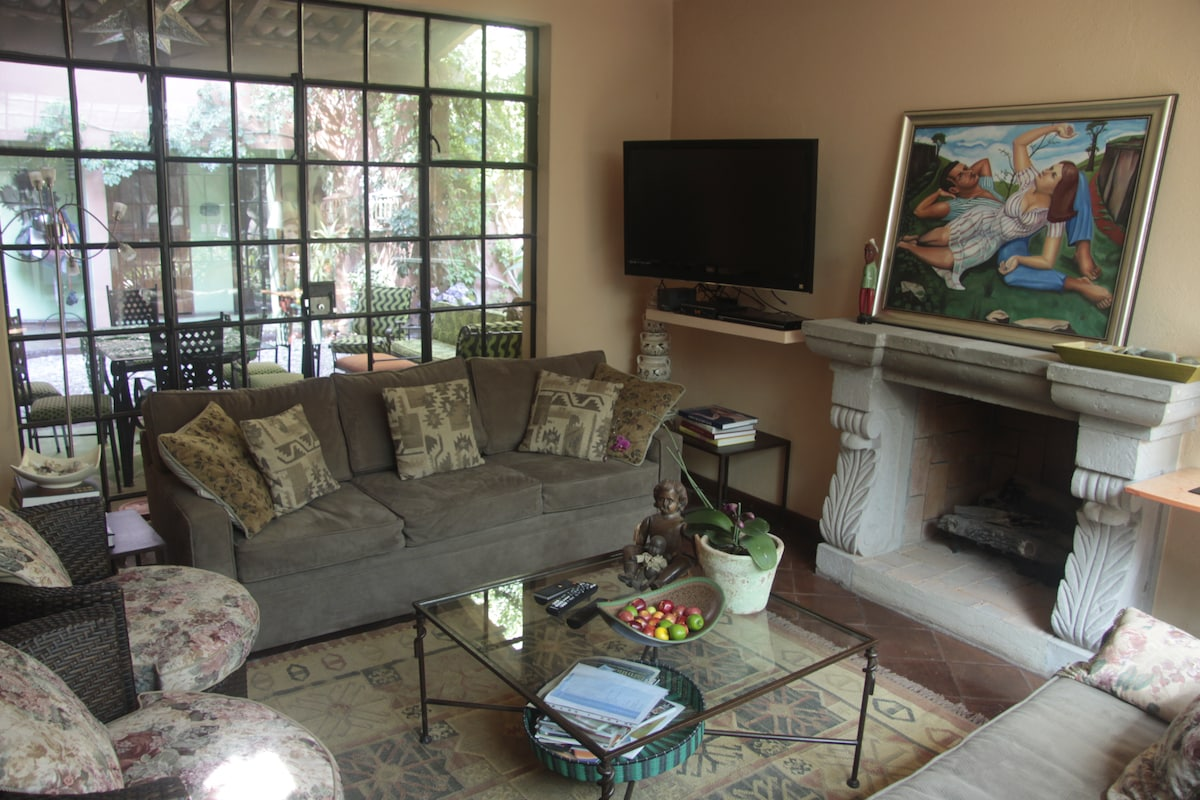 """One of the two sofas in the comfy living room, with 42"""" TV, DVD player and satellite TV."""