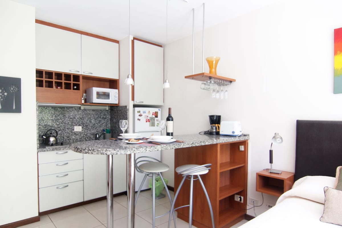 Cheerful and modern full equiped kitchen with: fridge w/freezer, microwave, electric hob, electric toaster, coffee machine